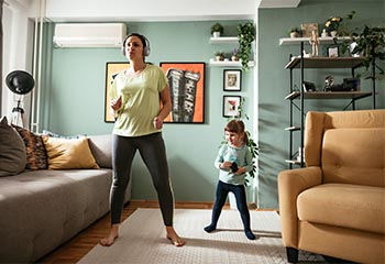 Lady and her daughter exercising at home