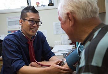 Dr Kwok Tsang working with patient