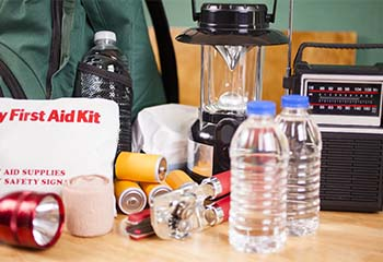 Medical emergency kit including a first aid kit, water bottles, lantern, radio and backpack