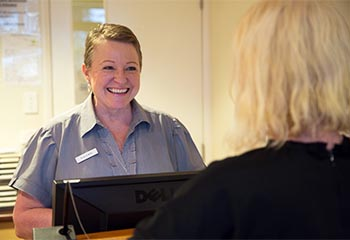 Toowoomba Medical staff member greeting patient in waiting room